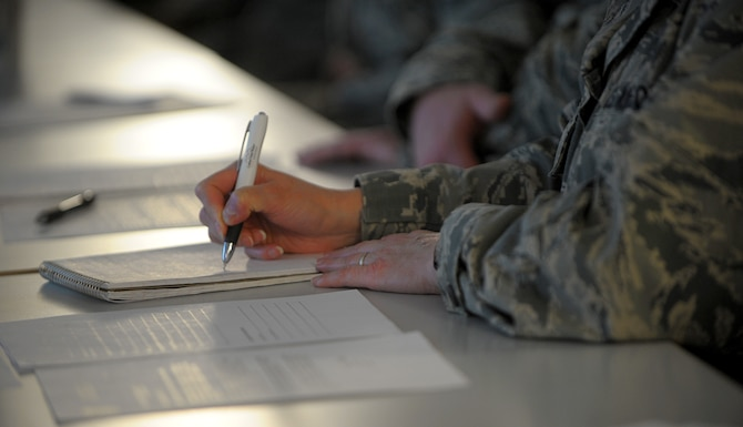 Col. Kelly Christy, 86th Aeromedical Evacuation Squadron commander, takes notes during a Continuous Process Improvement Senior Leader Course at Ramstein Air Base, Germany, Jan. 9, 2017. Christy was among more than 40 leaders, to include chief master sergeants, who attended one of the two courses held during the week. (U.S. Air Force photo by Staff Sgt. Timothy Moore)