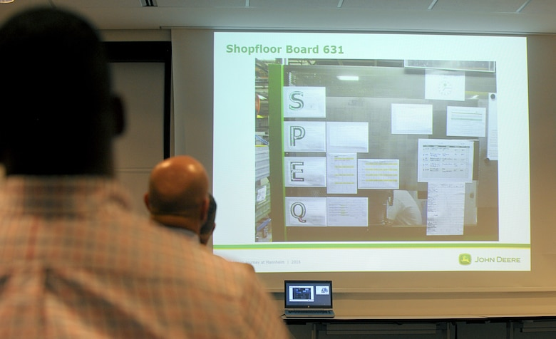 Attendees of a Continuous Process Improvement Senior Leader Course view a board used to monitor progress and change suggestions at a John Deere factory in Mannheim, Germany, Jan. 10, 2017. The students of the course traveled to Mannheim from Ramstein Air Base to see firsthand how a company implements some of the tools they learned in the course. (U.S. Air Force photo by Staff Sgt. Timothy Moore)