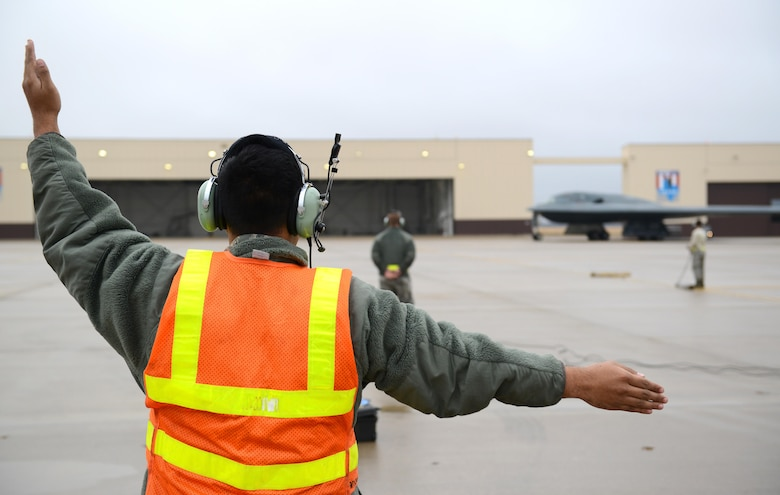 A crew chief from Whiteman Air Force Base, Mo., marshals in a B-2 Spirit stealth bomber at Whiteman Air Force Base, Mo., Jan. 19, 2017. Two B-2 Spirit stealth bombers returned after flying an approximate 30-hour sortie in support of operations near Sirte, Libya. In conjunction with the Libyan Government of National Accord, the U.S. military conducted precision airstrikes Jan. 18, 2017, destroying two Daesh camps 45 kilometers southwest of Sirte. (U.S. Air Force photo by Senior Airman Joel Pfiester)