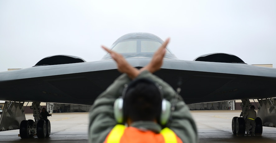 A crew chief from Whiteman Air Force Base, Mo., marshals in a B-2 Spirit stealth bomber at Whiteman Air Force Base, Mo., Jan 19, 2017. Two B-2 Spirit stealth bombers returned after flying an approximate 30-hour sortie in support of operations near Sirte, Libya. In conjunction with the Libyan Government of National Accord, the U.S. military conducted precision airstrikes Jan. 18, 2017, destroying two Daesh camps 45 kilometers southwest of Sirte. (U.S. Air Force photo by Senior Airman Joel Pfiester)