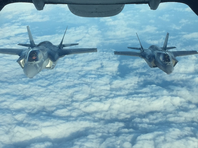 Two Marine Fighter Attack Squadron 121 (VMFA-121) F-35Bs en route to Iwakuni, Japan, fly in formation after receiving fuel from a Travis Air Force Base, California KC-10 Extender, Jan. 18, 2017. Air Mobility Command aerial refueling aircraft enable worldwide missions through force extension, making combat operations and partner nation support possible. (courtesy photo)