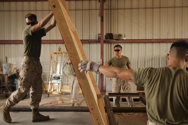 Marines assigned through the fleet assistance program with Headquarters and Headquarters Squadron, assist with range maintenance by pre-fabricating wooden targets to support tenant and visiting commands during Weapons and Tactics Instructors course 1-17 aboard Marine Corps Air Station Yuma, Ariz., September 29, 2016.