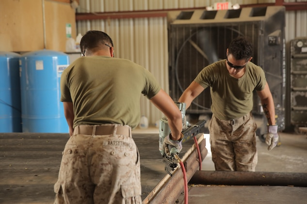 Lance Cpl. Dominic Ratsythong and Lance Cpl. Jacob Moreno, assigned through the fleet assistance program with Headquarters and Headquarters Squadron, assist with range maintenance by pre-fabricating wooden targets to support tenant and visiting commands during Weapons and Tactics Instructors course 1-17 aboard Marine Corps Air Station Yuma, Ariz., September 29, 2016.
