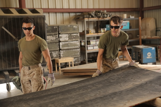 Cpl. Layton Knight and Lance Cpl. Jacob Moreno, assigned through the fleet assistance program with Headquarters and Headquarters Squadron, assist with range maintenance by pre-fabricating wooden targets to support tenant and visiting commands during Weapons and Tactics Instructors course 1-17 aboard Marine Corps Air Station Yuma, Ariz., September 29, 2016.
