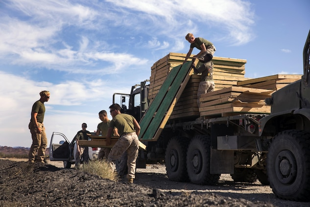 Marines assigned through the fleet assistance program with Headquarters and Headquarters Squadron, stationed at Marine Corps Air Station Yuma, Ariz., assist the range maintenance section by placing pre-assembled wooden targets in the Chocolate Mountain Aerial Gunnery Range to support Weapons and Tactics Instructors course 1-17 aboard MCAS Yuma, Ariz., Saturday, October 8, 2016.