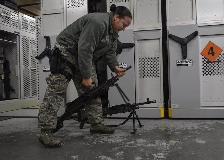 U.S. Air Force Senior Airman Jazmine Tingle, 19th Security Forces Squadron armorer, showcases the variety of weapons guarded at the base armory Jan. 17, 2017, at Little Rock Air Force Base, Ark. 19th SFS Defenders are qualified to use a range of weapons including the M240B machine gun, M4 assault rifle and 9mm handgun. (U.S. Air Force photo/Senior Airman Harry Brexel)