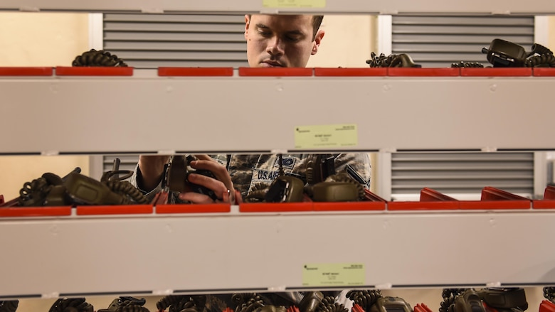 U.S. Air Force Staff Sgt. Ryan Quade, 19th Security Forces Squadron NCO in charge of the armory, inventories handheld radios prior to gearing up Airmen Jan. 17, 2017, at Little Rock Air Force Base, Ark. Defenders guard entry control points, conduct vehicle searches, patrol restricted areas and respond to emergencies 24/7. (U.S. Air Force photo/Senior Airman Harry Brexel)