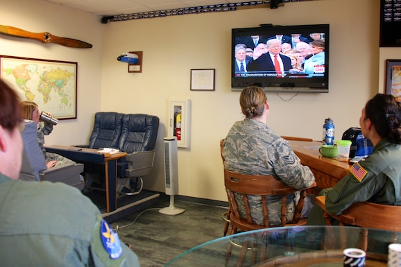 932nd Airlift Wing members watch the inauguration of the 45th President of the United States, Donald Trump, as he takes the oath of office on Friday, January 20, 2017, as seen from the 932nd Operation Group, Scott Air Force Base, Ill.  (U.S. Air Force photo by Lt. Col. Stan Paregien)