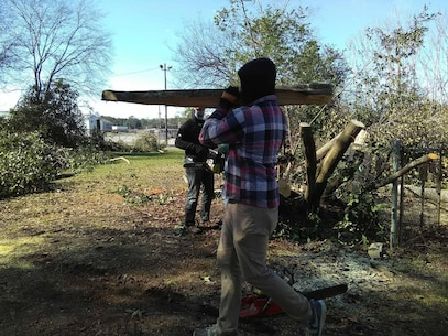Marines assist their off-base neighbor with cutting up trees and removing debris after severe storms that swept through the city of Albany, Ga., and surrounding counties, Jan. 2.