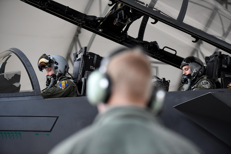 Col. Christopher Sage (left), 4th Fighter Wing commander, and Capt. Michael Piazza (right), 335th Fighter Squadron weapons system officer, prepare for takeoff during Razor Talon, Jan. 20, 2017, at Seymour Johnson Air Force Base, North Carolina. This is the first time Sage is participating in Razor Talon which combines sea, land and air units from all service branches in a realistic training environment. (U.S. Air Force photo by Airman 1st Class Kenneth Boyton)