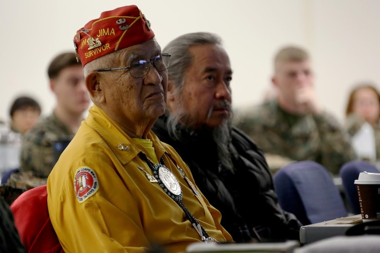 Navajo code talker Thomas Begay, left, listens to a speech given by Brig. Gen. Matthew Glavy, aboard Marine Corps Air Station Cherry Point, N.C., Jan. 17, 2017. Glavy and Begay spoke to Marines assigned to Marine Unmanned Aerial Vehicle Squadron 2, Marine Aircraft Group 14, 2nd Marine Aircraft Wing, in regards to the past, present and future of the Marine Corps. Glavy is the 2nd MAW commanding general. (U.S. Marine Corps photo by Cpl. Jason Jimenez/ Released)