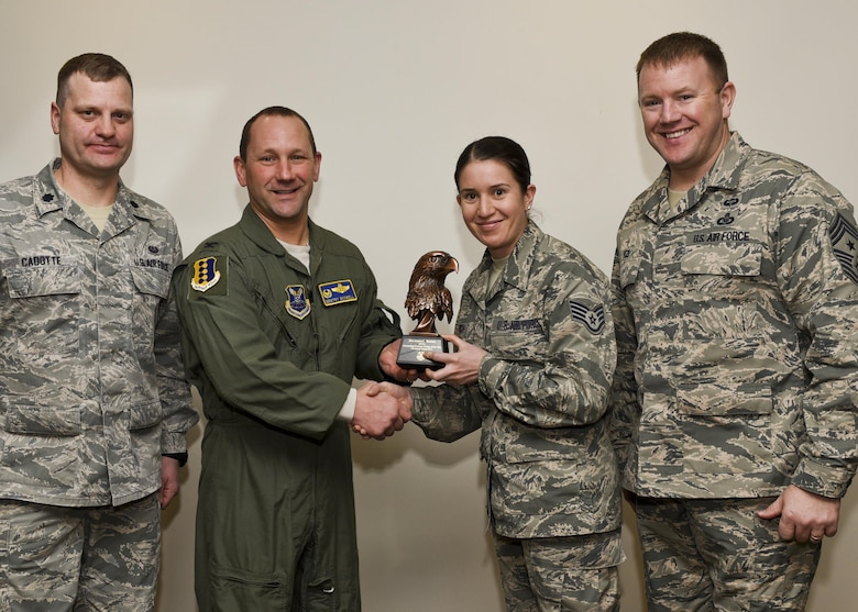 Col. Gentry Boswell, the 28th Bomb Wing commander, presents Staff Sgt. Jessica Benisch, a paralegal assigned to the 28th Bomb Wing Legal Office, with the Castleman Award, on Jan. 12, 2017, at Ellsworth Air Force Base, S.D. The award recognizes her as the most outstanding paralegal in Air Force Global Strike Command for 2015. (U.S. Air Force photo by Airman 1st Class Randahl J. Jenson)