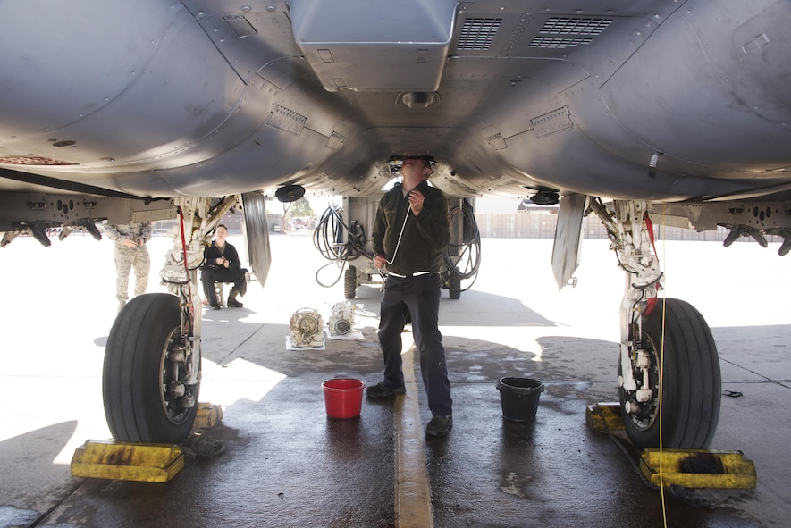 U.S. Air Force Staff Sgt. Mark Siefner, a crew chief with the 334th Aircraft Maintenance Unit, out of Seymour Johnson Air Force Base, N.C., repairs an F-15E Strike Eagle at Davis-Monthan AFB, Ariz., Jan. 18, 2017. New pilots from the 334th Fighter Squadron participated in a two week training course with the F-15E throughout southern Arizona's military operating areas. (U.S. Air Force photo by Airman 1st Class Giovanni Sims)