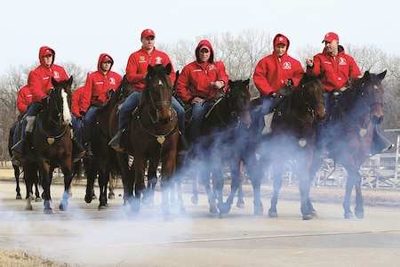 Troopers of the 1st Infantry Division Commanding General's Mounted Color Guard ride past a fog machine used to simulate steam on Fort Riley Jan. 11 as part of a training session before departing for the 58th Presidential Inaugural Parade in Washington Jan. 20. The training session consisted of using sirens, horns, fog and other objects the horses may encounter during the parade as a way to desensitize the team to anything that may startle the horses.