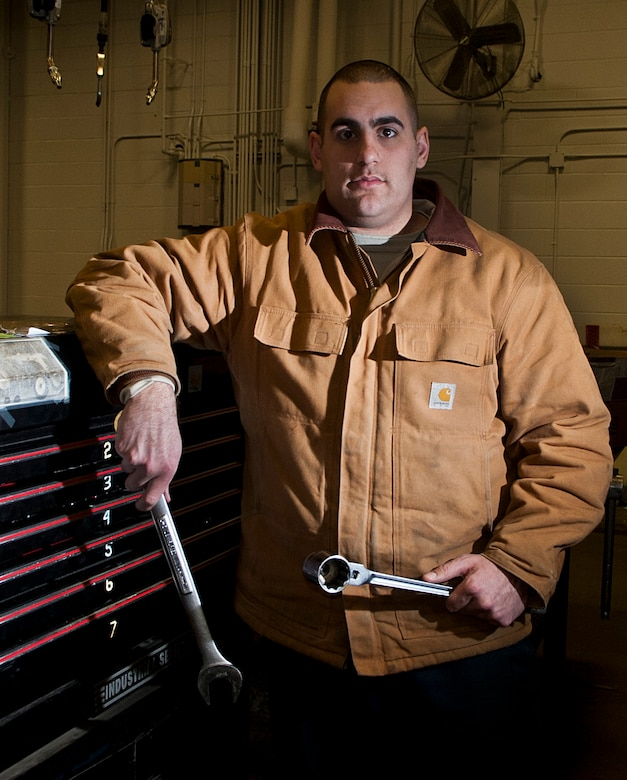 Senior Airman Kevin Sylvia, 5th Logistics Readiness Squadron vehicle maintenance technician, holds maintenance tools at Minot Air Force Base, N.D., Jan. 4, 2017. The 5 LRS special purpose maintainers are trained to perform inspections, repairs and rebuild vehicle components and assemblies. (U.S. Air Force photo/Airman 1st Class Jonathan McElderry)
