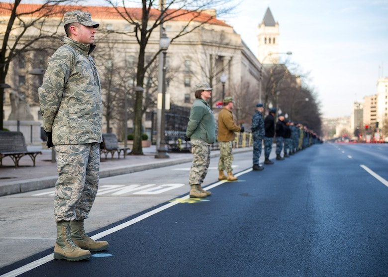 Airmen and Sailors stand along Pennsylvania Avenue during the 58th Presidential Inauguration cordon and parade practice held in Washington, D.C., Jan. 15, 2017. The Parade route spans 1 1/2 miles, from the U.S. Capitol to the White House. (U.S. Air Force photo by Airman Gabrielle Spalding)
