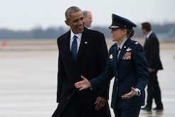 Former President Barack Obama is greeted by Col. Julie A. Grundahl, 11th Wing and Joint Base Andrews vice commander, on the flightline at Joint Base Andrews, Md., before his farewell address, Jan. 20, 2017. Throughout his eight-year tenure as president, Obama traveled to and from JBA aboard Air Force One more than 600 times and traveling all over the world.