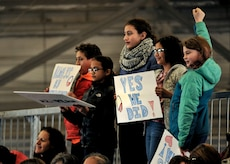Children hold signs in support of former President Barack Obama during his farewell speech at Joint Base Andrews, Md. Jan. 20, 2017. After his speech Obama and his wife Michelle took time to shake hands and exchange hugs with members of the crowd before boarding a plane to depart.