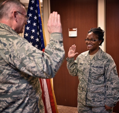 "Master Sgt. Barbara Owens, career development section chief, 932nd Force Support Squadron takes the oath of enlistment with Col. Jonathan Philebaum, commander, 932nd Airlift Wing, Jan. 20, 2017, Scott Air Force Base, Illinois. Owens, who helps fellow Airman with career planning, to include reenlistments, wanted to lead by example and show that she too has a requirement to reenlist to continue her military service. ""I wanted to embrace something different and for me it doesn't matter who is our Commander in Chief, I made a commitment and wanted to lead by example for younger Airman,"" said Owens.  (U.S. Air Force photo by Christopher Parr)"