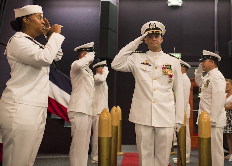 JOINT BASE PEARL HARBOR-HICKAM, Hawaii (January 20, 2017) Cmdr. Gary Montalvo is piped ashore during the Virginia-class fast-attack submarine USS North Carolina (SSN 777) change of command at Sharkey Theater in Joint Base Pearl Harbor-Hickam. Montalvo was relieved by Cmdr. Matthew Lewis. (U.S. Navy Photo by Mass Communication Specialist 2nd Class Michael H. Lee)