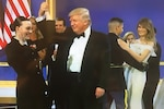 President Donald J. Trump dances with Navy Petty Officer 2nd Class Catherine Cartmell during the Salute to Our Armed Services
