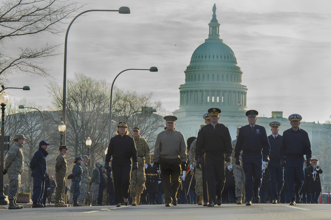 U.S. military leadership march during the Department of Defense inaugural parade dress rehearsal in the District of Columbia, Jan. 15, 2017. Approximately 5,000 service members participated in the musical elements, color guards, salute batteries and honor cordons for the parade rehearsal. (U.S. Air Force photo by Airman 1st Class Valentina Lopez)