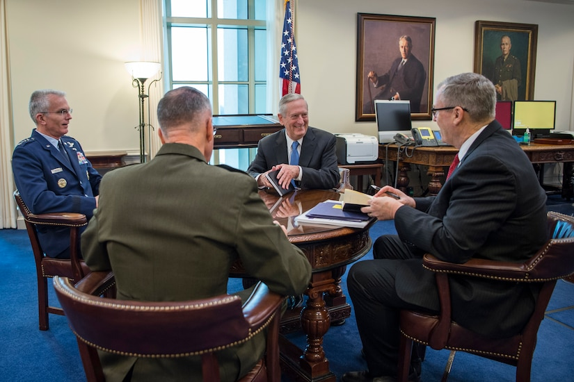 Clockwide from top, Defense Secretary Jim Mattis meets with Deputy Defense Secretary Bob Work; Marine Corps Gen. Joe Dunford, chairman of the Joint Chiefs of Staff; and Air Force Gen. Paul J. Selva, vice chairman of the Joint Chiefs of Staff, at the Pentagon, Jan. 21, 2017. DoD photo by Air Force Tech. Sgt. Brigitte N. Brantley