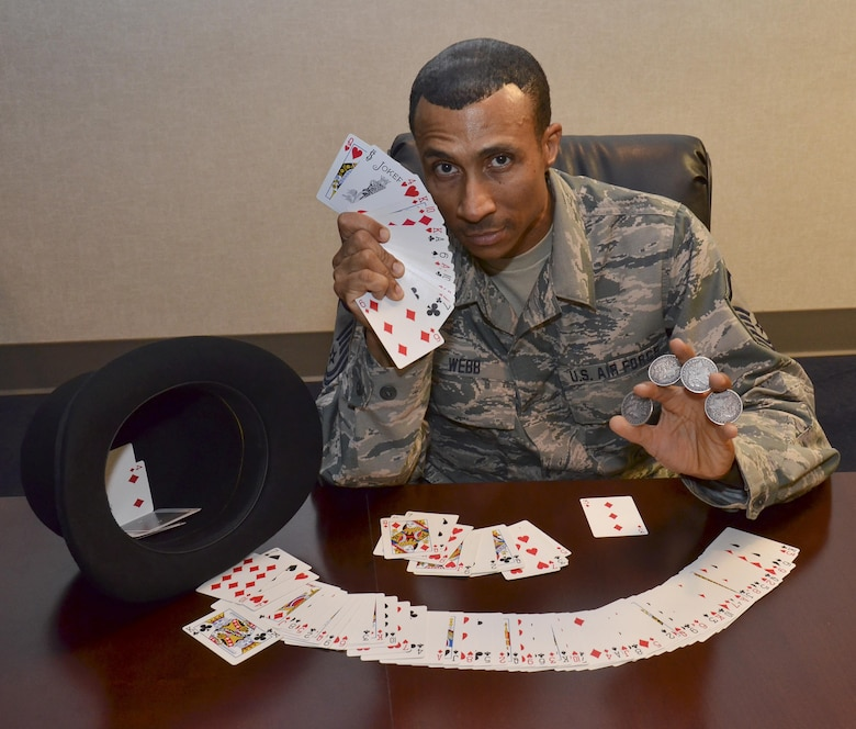 Master Sgt. Micheal Webb displays cards used in magic tricks at the 117 Air Refueling Wing, Birmingham, Ala., Oct. 15, 2016.  (U.S. Air National Guard photo by Staff Sgt. Jeremy Farson)