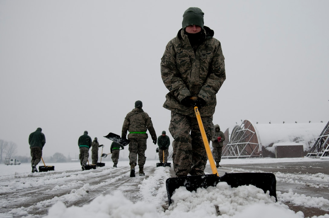 U.S. Air Force aircraft maintainers from the 25th Aircraft Maintenance Unit shovel snow in front of aircraft hangars on Osan Air Base, Republic of Korea, Jan. 20, 2017. The 25th AMU maintains the A-10 Thunderbolt IIs assigned to the 25th Fighter Squadron. (U.S. Air Force photo by Staff Sgt. Jonathan Steffen)