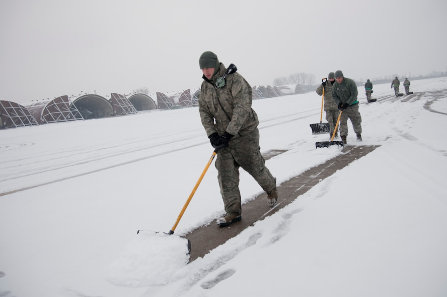 "U.S. Air Force aircraft maintainers from the 25th Aircraft Maintenance Unit shovel snow on the flight line at Osan Air Base, Republic of Korea, Jan. 20, 2017. The 25th AMU removed snow in front of their hangers to keep the A-10 Thunderbolt II ""ready to fight tonight"".  (U.S. Air Force photo by Staff Sgt. Jonathan Steffen)"