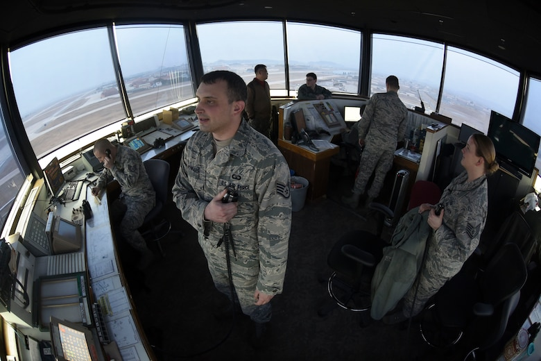 Air traffic control airmen perform operations in the airfield tower at Kunsan Air Base, Republic of Korea, Jan. 5, 2017. ATC ensures the safety of aircraft in the airspace around Kunsan. (U.S. Air Force photo by Senior Airman Michael Hunsaker/Released)