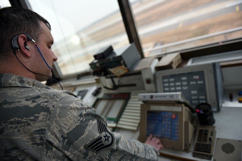 Staff Sgt. Jeffery Howard, 8th Operations Support Squadron air traffic controller, adjusts his radio frequency at Kunsan Air Base, Republic of Korea, Jan. 5, 2017. Howard's primary responsibilities include communicating with aircraft entering and leaving Kunsan airspace. (U.S. Air Force photo by Senior Airman Michael Hunsaker/Released)