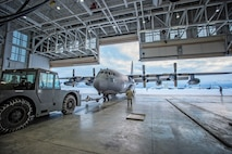 "Current and former members of the 211th Rescue Squadron, Alaska Air National Guard, bid farewell to the last of their HC-130N aircraft (tail number 2106) Jan. 17 as it departed here for Patrick Air Force Base, Florida. The HC-130 variants of the C-130 family of aircraft are designed for long-range search-and-rescue missions. They are set up to provide command and control, airdrop of pararescue personnel and equipment, and perform air-refueling missions for helicopters like the HH-60 Pave Hawk helicopters flown by the 211th's sister unit, the 210th Rescue Squadron. The older HC-130N's are scheduled to be replaced with four new HC-130J ""Combat King II"" aircraft which are currently being manufactured at Lockheed Martin in Georgia. (U.S. Air National Guard photo by Staff Sgt. Edward Eagerton/released)"
