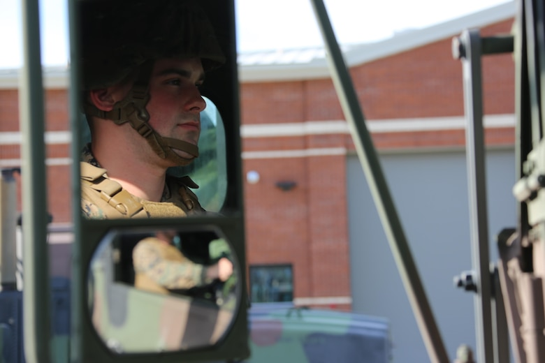 Cpl. Jimmy Moretz operates an MK28 extended cargo truck aboard Marine Corps Air Station Cherry Point, N.C., Jan. 17, 2017. Moretz is the emergency dispatcher assigned to Marine Air Support Squadron 1, Marine Air Control Group 28, 2nd Marine Aircraft Wing, and training noncommissioned officer for his platoon in the motor and transport section of the squadron. Moretz has been recognized as the noncommissioned officer of the quarter for the period of Oct. 1, 2016 to Dec. 31, 2016 for his outstanding work in his squadron. (U.S. Marine Corps photo by Cpl. Jason Jimenez/ Released)