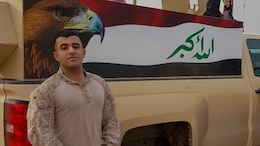 Cpl. Ali J. Mohammed, a Baghdad, Iraq native and a supply Marine with 3rd Battalion, 7th Marine Regiment, Special Purpose Marine Air-Ground Task Force-Crisis Response-Central Command, stands in front of the painting an Iraqi flag while in Northern Iraq, Dec. 26, 2016. Mohammed, fluent in Arabic, has strengthened the partnership between SPMAGTF Marines and Iraqi military members by translating pertinent information to support their operations. SPMAGTF Marines enable Combined Joint Task Force-Operation Inherent Resolve with security forces, strikes, and advise and assist teams, all of which support the Iraqis in their efforts to defeat ISIL.