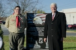 Travis Hartlaub stands with retired Navy Vice Adm. Keith Lippert in front of his completed veteran's memorial Eagle Scout project at the Littlestown Community Park.