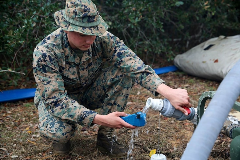 Cpl. Abraham Ostosmendoza tests water during a field exercise aboard Marine Corps Auxiliary Landing Field Bogue, Dec. 6, 2016. Ostosmendoza is a water support technician assigned to Marine Wing Support Squadron 271, Marine Aircraft Group 14, 2nd Marine Aircraft Wing.