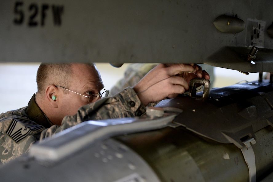 Chief Master Sgt. Craig Brandenburg, 52nd Maintenance Group wing weapons manager, loads an inert bomb on an F-16 Fighting Falcon during the chief load crew competition in Hanger One at Spangdahlem Air Base, Germany, Jan. 20, 2017. The competition pitted a group of three senior leaders against an active load crew as part of the lead-up to the Annual Load Crew Competition. (U.S. Air Force photo by Staff Sgt. Staci Miller)