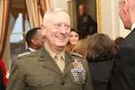 Marine Corps Gen. James N. Mattis speaks with guests during a joint retirement reception for him and Gen. John R. Allen at the Home of the Commandants in Washington, Apr. 4, 2013. Marine Corps photo by Cpl. Tia Dufour