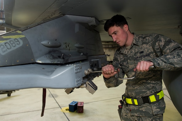 Airman 1st Class John Gaddis, 52nd Aircraft Maintenance Squadron tactical aircraft weapons system specialist, prepares an F-16 Fighting Falcon for inert weapons during the annual weapons load competition in Hangar One at Spangdahlem Air Base, Germany, Jan. 20, 2017. The two competing teams of three Airmen competed for the title of wing's best load crew. The winning team's completion time will be compared to other squadrons in the Major Command to determine the best load crew in United States Air Forces in Europe. Wing winners will be announced at the Maintenance Professional of the Year banquet here March 10, 2017. (U.S. Air Force photo by Airman 1st Class Preston Cherry)