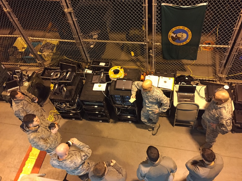 Memebers of the Air National Gaurd (ANG), 242nd Combat Communications (242CBCS) Squadron, Fairchild Air Force Base, Spokane, Wash., provide radio communication via saltellite during the support of the 2017 Presidential Inauguration at the FEDEX Field, Landover Md. 20 Jan.