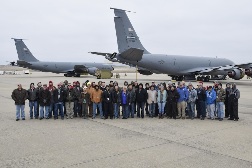 Members of the 564th Aircraft Maintenance Squadron Block 45 avionics modification team pose on the flight line near two KC-135Rs undergoing upgrade Dec. 15, 2016, Tinker Air Force Base, Oklahoma. Four spots on the south ramp are designated exclusively for the Block 45 upgrade. (U.S. Air Force photo/Greg L. Davis)