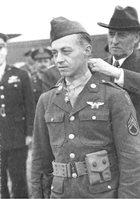 For his actions, Staff Sgt. Maynard Smith was awarded the Congressional Medal of Honor by the Secretary of War, Henry L. Stimson. (Air Force photo)