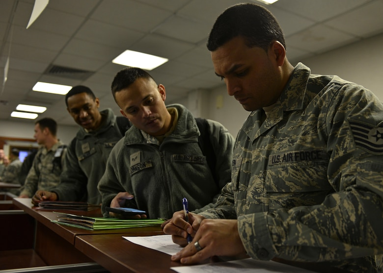 Airmen from the 31st Fighter Wing process through the personnel deployment function line at Aviano Air Base, Italy on Jan. 21, 2017. The Airmen traveled to Souda Bay, Greece, to support a flying training deployment with the Hellenic air force. (U.S. Air Force photo by Senior Airman Cary Smith)