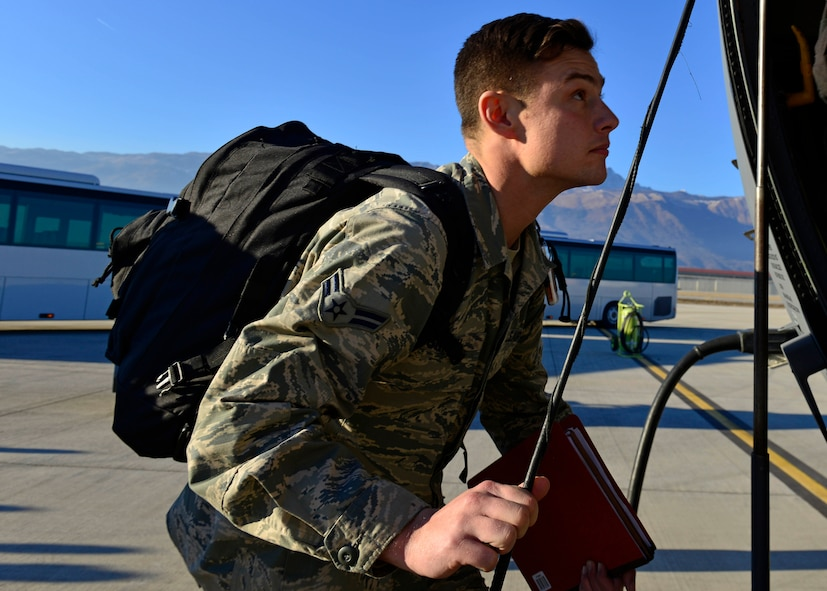 An Airman from the 31st Fighter Wing boards a C-130 Hercules at Aviano Air Base, Italy on Jan. 21, 2017 on their way to Souda Bay, Greece. The Airmen traveled to Souda Bay, Greece, to support a flying training detachment with the Hellenic air force. (U.S. Air Force photo by Senior Airman Cary Smith)