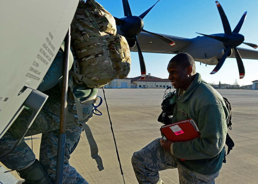 An Airman from the 31st Fighter Wing boards a C-130 Hercules at Aviano Air Base, Italy on Jan. 21, 2017 on their way to Souda Bay, Greece. Approximately 300 personnel from the 31st Fighter Wing and Arizona Air National Guard's 161st Air Refueling Wing traveled to Greece for a flying training deployment with the Hellenic air force. (U.S. Air Force photo by Senior Airman Cary Smith)