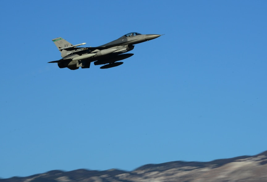 A 555th Fighter Squadron F-16 Fighting Falcon departs from Aviano Air Base, Italy on Jan. 21, 2016 to support a flying training deployment in Souda Bay, Greece. Fourteen F-16s, one KC-135 Stratotanker from the Arizona Air National Guard's 161st Air Refueling Wing, and 280 Airmen deployed to Souda Bay to train with Greece's Hellenic air force. (U.S. Air Force photo by Staff Sgt. Krystal Ardrey)