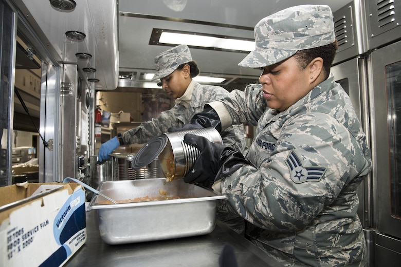 U.S. Air Force Senior Airman Kandaace Kirk, from the 116th Air Control Wing (ACW) Services Flight, Georgia Air National Guard (ANG), pours a can of mixed vegetables in a pan while preparing dinner for joint-forces personnel supporting the 58th Presidential Inauguration, Washington, D.C., January 19, 2017. A team of 10 Airmen from the 116th ACW deployed with their Disaster Relief Mobile Kitchen Trailer, or DRMKT.  Working from FedEx Field, home to the Washington Redskins, the team worked along side services teams from other ANG units across the nation preparing and serving meals to about 3,500 joint-force members per day deployed to the National Capital Region. In all, about 7,500 National Guard Soldiers and Airmen, from 44 states, three territories and the District of Columbia, served with the specially created Joint Task Force – District of Columbia. As a whole, National Guard Soldiers and Airmen augmented the U.S. Secret Service, U.S. Capitol Police and D.C. Metropolitan Police forces on a range of support including traffic control, crowd management, logistics and communication. (U.S. Air National Guard photo by Senior Master Sgt. Roger Parsons)