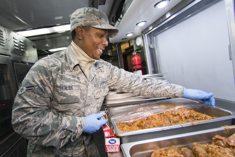 U.S. Air Force Airman 1st Class Dasmon Henley from the 116th Air Control Wing (ACW) Services Flight, Georgia Air National Guard (ANG), prepares a tray of spaghetti during dinner preparation for joint-forces personnel supporting the 58th Presidential Inauguration, Washington, D.C., January 18, 2017. A team of 10 Airmen from the 116th ACW deployed with their Disaster Relief Mobile Kitchen Trailer (DRMKT).  Working from FedEx Field, home to the Washington Redskins, the team worked along side services teams from other ANG units across the nation preparing and serving meals to about 3,500 joint-force members per day deployed to the National Capital Region. In all, about 7,500 National Guard Soldiers and Airmen, from 44 states, three territories and the District of Columbia, served with the specially created Joint Task Force – District of Columbia. As a whole, National Guard Soldiers and Airmen augmented the U.S. Secret Service, U.S. Capitol Police and D.C. Metropolitan Police forces on a range of support including traffic control, crowd management, logistics and communication. (U.S. Air National Guard photo by Senior Master Sgt. Roger Parsons)