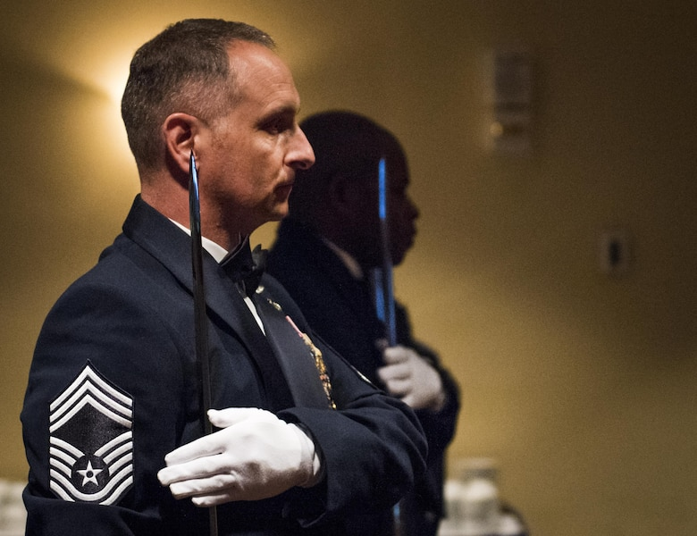 Chief master sergeants bring their sabers to rest at their shoulder during a recognition ceremony Jan. 20 at Eglin Air Force Base, Fla.  Six new chiefs were recognized during the formal ceremony and dinner.  (U.S. Air Force photo/Samuel King Jr.)